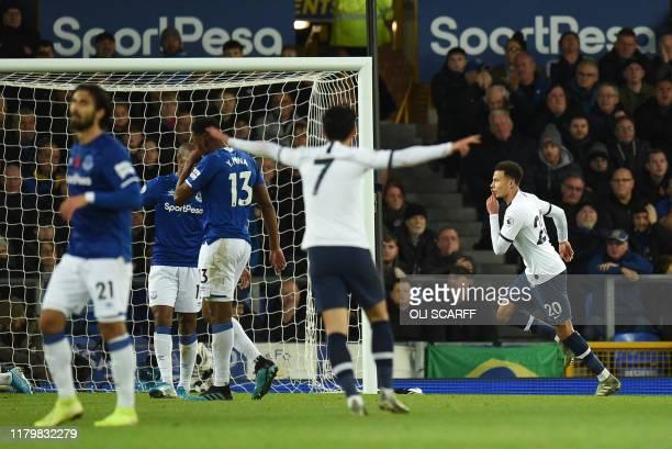 Tottenham Hotspur's English midfielder Dele Alli celebrates scoring his team's first goal during the English Premier League football match between...