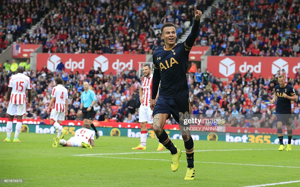 Tottenham Hotspur's English midfielder Dele Alli celebrates scoring his team's third goal during the English Premier League football match between Stoke City and Tottenham Hotspur at the Bet365 Stadium in Stoke-on-Trent, central England on September 10, 2016. / AFP / Lindsey PARNABY / RESTRICTED TO EDITORIAL USE. No use with unauthorized audio, video, data, fixture lists, club/league logos or 'live' services. Online in-match use limited to 75 images, no video emulation. No use in betting, games or single club/league/player publications. /