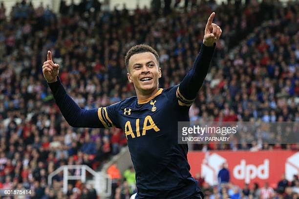 Tottenham Hotspur's English midfielder Dele Alli celebrates scoring his team's third goal during the English Premier League football match between...
