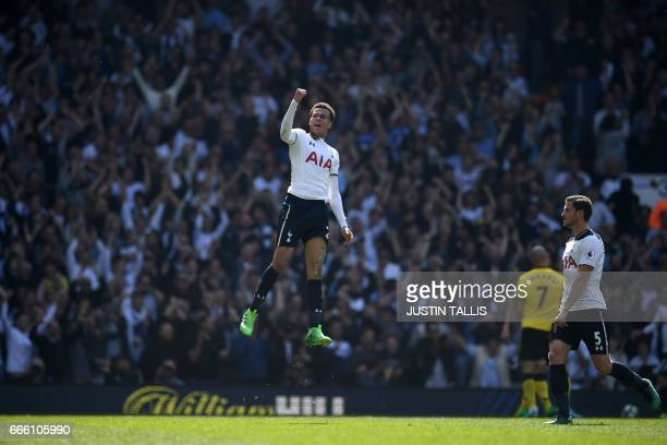 Tottenham Hotspur's English midfielder Dele Alli celebrates scoring his team's first goal during the English Premier League football match between...
