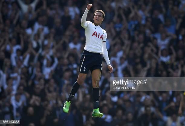 TOPSHOT Tottenham Hotspur's English midfielder Dele Alli celebrates scoring his team's first goal during the English Premier League football match...
