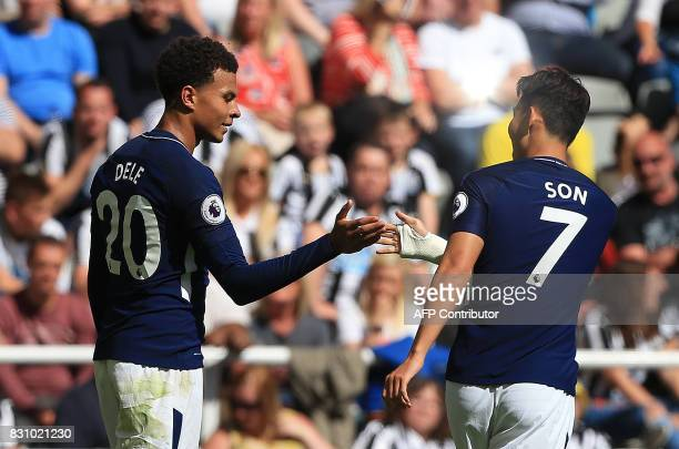 Tottenham Hotspur's English midfielder Dele Alli celebrates scoring the opening goal during the English Premier League football match between...
