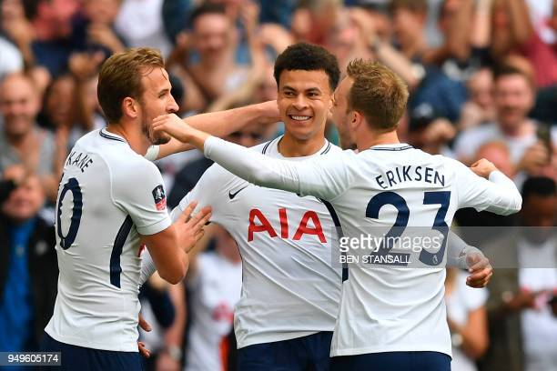 Tottenham Hotspur's English midfielder Dele Alli celebrates scoring the opening goal with teammates Tottenham Hotspur's English striker Harry Kane...