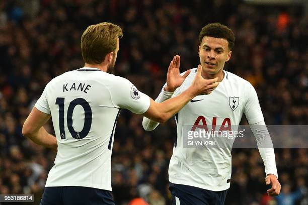 Tottenham Hotspur's English midfielder Dele Alli celebrates scoring the opening goal with Tottenham Hotspur's English striker Harry Kane during the...