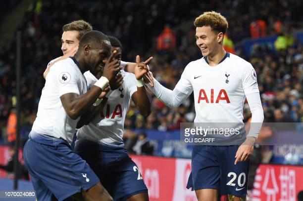 Tottenham Hotspur's English midfielder Dele Alli celebrates with Tottenham Hotspur's English midfielder Harry Winks and Tottenham Hotspur's French...