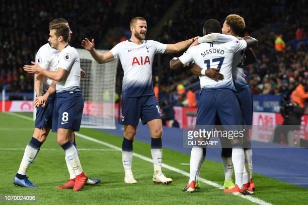 Tottenham Hotspur's English midfielder Dele Alli celebrates with Tottenham Hotspur's French midfielder Moussa Sissoko and Tottenham Hotspur's English...