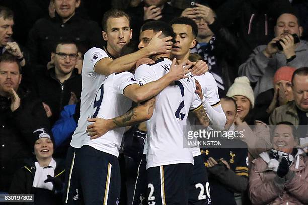 Tottenham Hotspur's English midfielder Dele Alli celebrates with teammates after scoring their first goal during the English Premier League football...