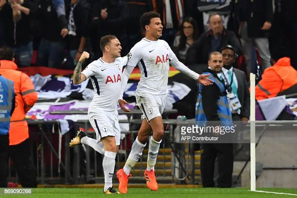 Tottenham Hotspur's English midfielder Dele Alli celebrates with Tottenham Hotspur's English defender Kieran Trippier after scoring the opening goal...