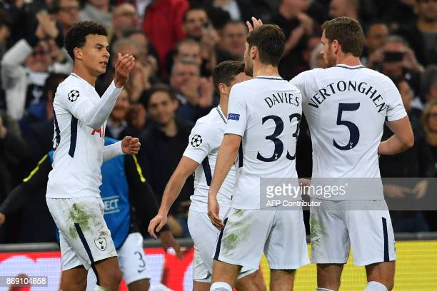 Tottenham Hotspur's English midfielder Dele Alli celebrates with teammates after scoring their second goal during the UEFA Champions League Group H...