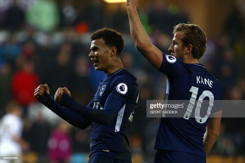 Tottenham Hotspur's English midfielder Dele Alli (L) celebrates with Tottenham Hotspur's English striker Harry Kane after scoring their second goal during the English Premier League football match between Swansea City and Tottenham Hotspur at The Liberty Stadium in Swansea, south Wales on January 2, 2018. Tottenham won the game 2-0. / AFP PHOTO / Geoff CADDICK / RESTRICTED TO EDITORIAL USE. No use with unauthorized audio, video, data, fixture lists, club/league logos or 'live' services. Online in-match use limited to 75 images, no video emulation. No use in betting, games or single club/league/player publications. /