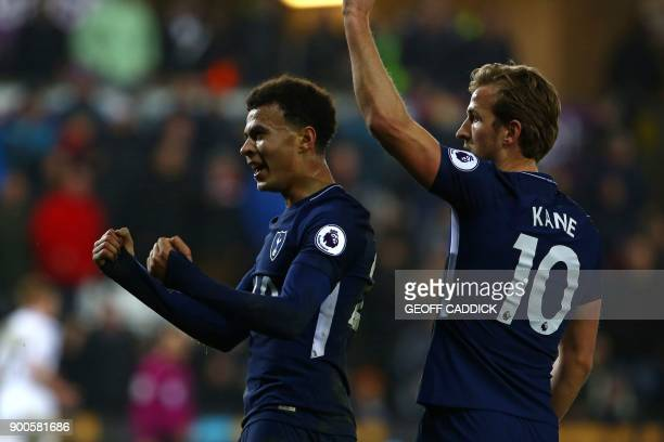 Tottenham Hotspur's English midfielder Dele Alli celebrates with Tottenham Hotspur's English striker Harry Kane after scoring their second goal...