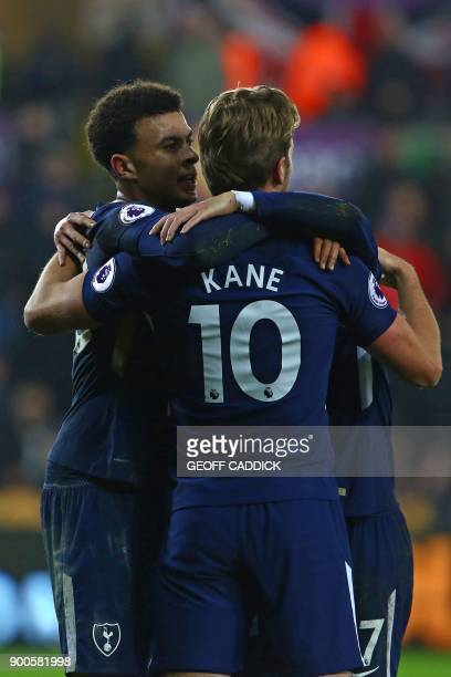 Tottenham Hotspur's English midfielder Dele Alli celebrates with Tottenham Hotspur's English striker Harry Kane and Tottenham Hotspur's South Korean...
