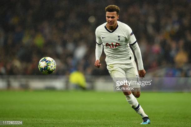 Tottenham Hotspur's English midfielder Dele Alli chases the ball during the UEFA Champions League Group B football match between Tottenham Hotspur...