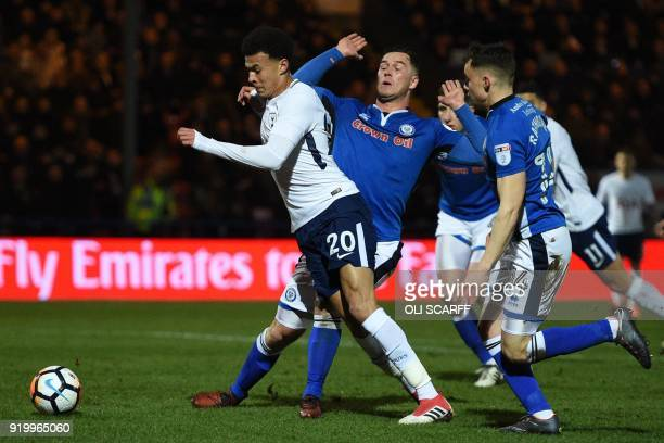 Tottenham Hotspur's English midfielder Dele Alli falls in the penalty area after a challenge from Rochdale's English defender Harrison McGahey...