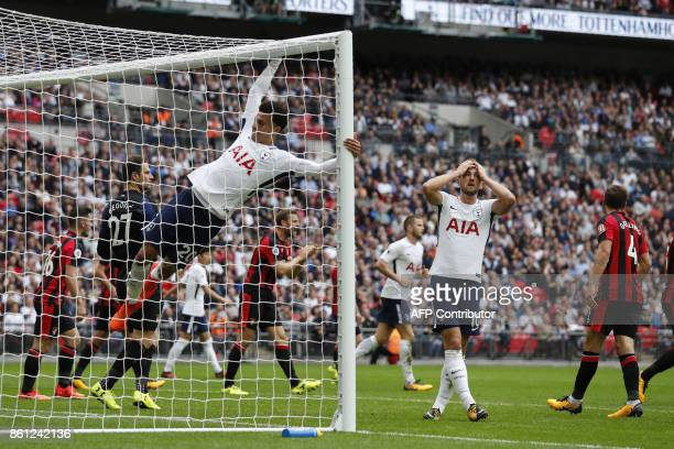Tottenham Hotspur's English midfielder Dele Alli hangs onto the goal posts as Tottenham Hotspur's English striker Harry Kane reacts to Tottenham...