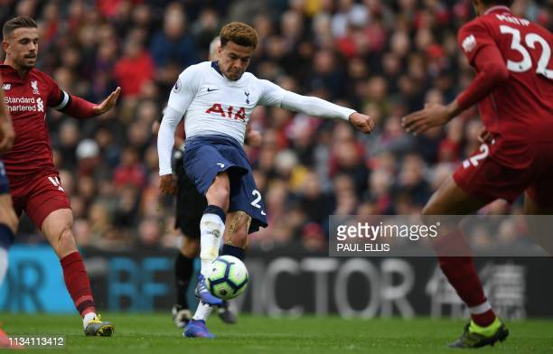 Tottenham Hotspur's English midfielder Dele Alli has an unsuccessful shot during the English Premier League football match between Liverpool and...
