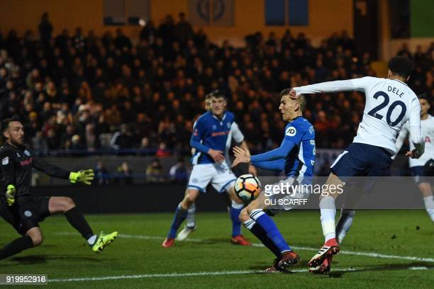 Tottenham Hotspur's English midfielder Dele Alli has an unsuccessful shot during the English FA Cup fifth round football match between Rochdale and...