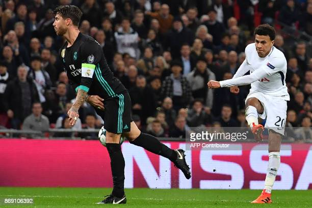 Tottenham Hotspur's English midfielder Dele Alli has this shot deflected off Real Madrid's Spanish defender Sergio Ramos for their second goal during...