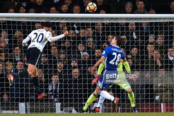 Tottenham Hotspur's English midfielder Dele Alli heads the opening goal past Chelsea's Belgian goalkeeper Thibaut Courtois during the English Premier...