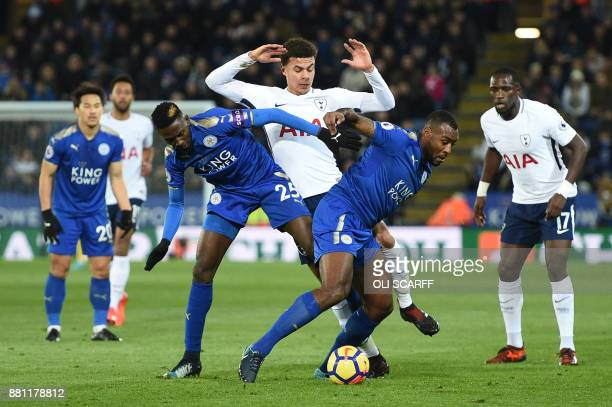 Tottenham Hotspur's English midfielder Dele Alli is blocked by Leicester City's Nigerian midfielder Wilfred Ndidi and Leicester City's Englishborn...