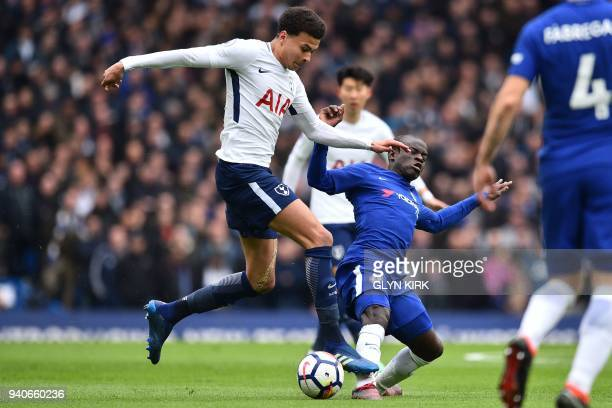 Tottenham Hotspur's English midfielder Dele Alli is tackled by Chelsea's French midfielder N'Golo Kante during the English Premier League football...