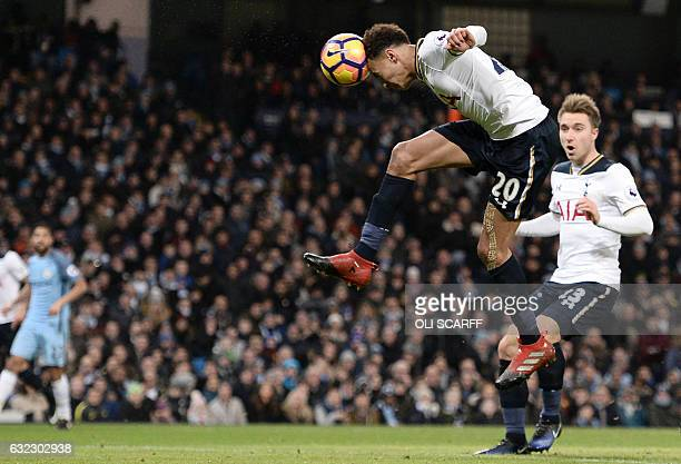 Tottenham Hotspur's English midfielder Dele Alli jumps to head their first goal during the English Premier League football match between Manchester...