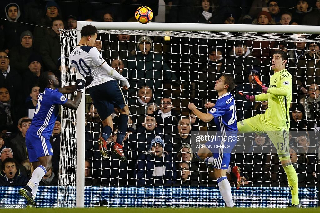 Tottenham Hotspur's English midfielder Dele Alli (2nd L) jumps to score his and Totenham's second goal with this header during the English Premier League football match between Tottenham Hotspur and Chelsea at White Hart Lane in London, on January 4, 2017. / AFP / Adrian DENNIS / RESTRICTED TO EDITORIAL USE. No use with unauthorized audio, video, data, fixture lists, club/league logos or 'live' services. Online in-match use limited to 75 images, no video emulation. No use in betting, games or single club/league/player publications. /