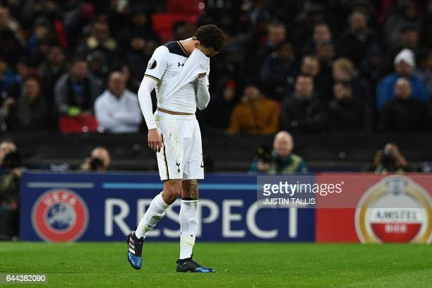 Tottenham Hotspur's English midfielder Dele Alli leaves the pitch after being sent off during the UEFA Europa League Round of 32 secondleg football...