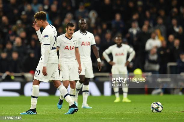 Tottenham Hotspur's English midfielder Dele Alli reacts after conceding their fourth goal during the UEFA Champions League Group B football match...