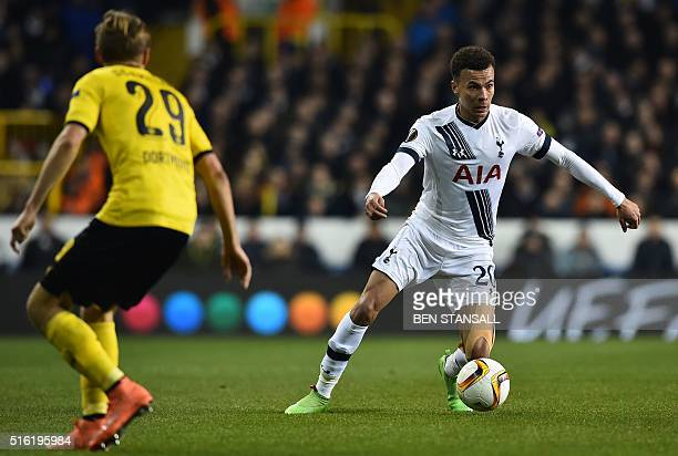 Tottenham Hotspur's English midfielder Dele Alli runs with the ball during the UEFA Europa League round of 16 second leg football match between...