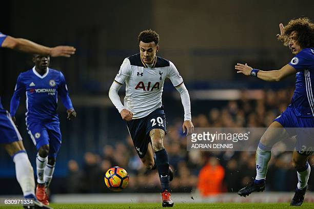 Tottenham Hotspur's English midfielder Dele Alli runs with the ball during the English Premier League football match between Tottenham Hotspur and...