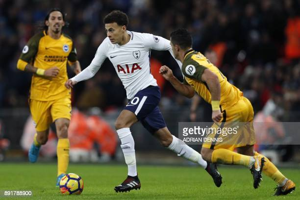 Tottenham Hotspur's English midfielder Dele Alli runs with the ball during the English Premier League football match between Tottenham Hotspur and...