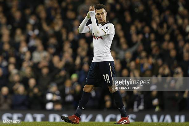Tottenham Hotspur's English midfielder Dele Alli scorer of two Tottenham goals applauds as he leaves the pitch substituted during the English Premier...