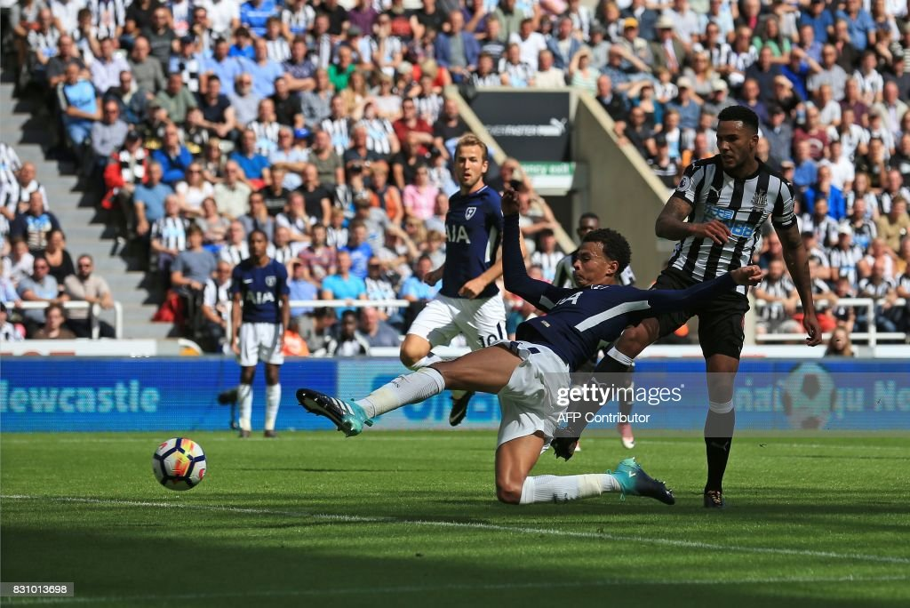 TOPSHOT - Tottenham Hotspur's English midfielder Dele Alli scores his team's first and the opening goal during the English Premier League football match between Newcastle United and Totenham Hotspur at St James' Park in Newcastle-upon-Tyne, north east England on August 13, 2017. / AFP PHOTO / Lindsey PARNABY / RESTRICTED TO EDITORIAL USE. No use with unauthorized audio, video, data, fixture lists, club/league logos or 'live' services. Online in-match use limited to 75 images, no video emulation. No use in betting, games or single club/league/player publications. /