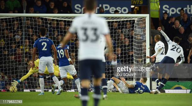 Tottenham Hotspur's English midfielder Dele Alli scores his team's first goal during the English Premier League football match between Everton and...