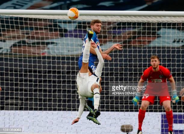 Tottenham Hotspur's English midfielder Dele Alli scores his team's opening goal during the UEFA Europa League Last 32 Second Leg football match...
