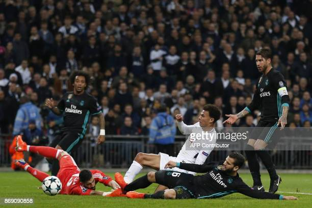 TOPSHOT Tottenham Hotspur's English midfielder Dele Alli scores past Real Madrid's Spanish goalkeeper Kiko Casilla during the UEFA Champions League...