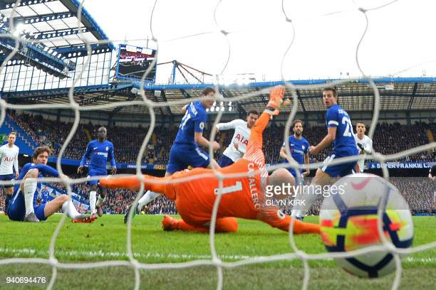 Tottenham Hotspur's English midfielder Dele Alli shoots past Chelsea's Argentinian goalkeeper Willy Caballero to score their third goal during the...