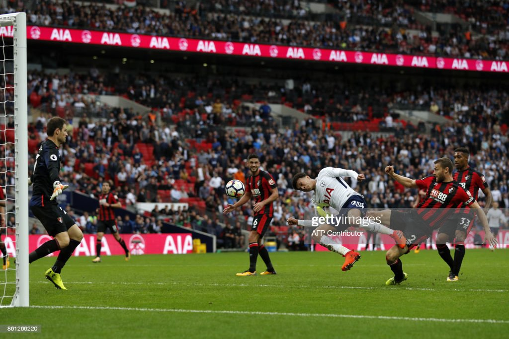 Tottenham Hotspur's English midfielder Dele Alli (3R) takes a header at goal during the English Premier League football match between Tottenham Hotspur and Bournemouth at Wembley Stadium in London, on October 14, 2017. / AFP PHOTO / Adrian DENNIS / RESTRICTED TO EDITORIAL USE. No use with unauthorized audio, video, data, fixture lists, club/league logos or 'live' services. Online in-match use limited to 75 images, no video emulation. No use in betting, games or single club/league/player publications. /