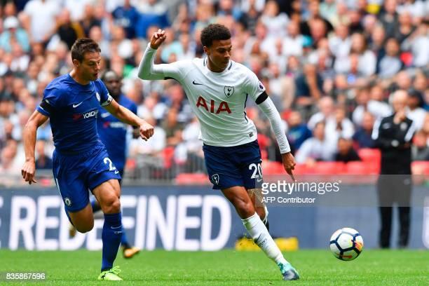 Tottenham Hotspur's English midfielder Dele Alli takes on Chelsea's Spanish defender Cesar Azpilicueta during the English Premier League football...