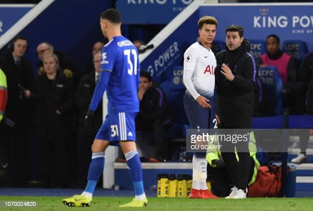 Tottenham Hotspur's English midfielder Dele Alli talks with Tottenham Hotspur's Argentinian head coach Mauricio Pochettino during the English Premier...