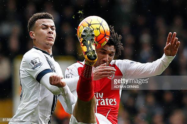Tottenham Hotspur's English midfielder Dele Alli vies with Arsenal's Egyptian midfielder Mohamed Elneny during the English Premier League football...