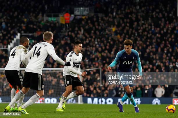Tottenham Hotspur's English midfielder Dele Alli vies with Fulham's Belgian defender Denis Odoi Fulham's German midfielder Andre Schurrle and...
