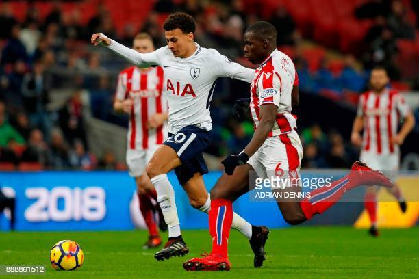 Tottenham Hotspur's English midfielder Dele Alli vies with Stoke City's French defender Kurt Zouma during the English Premier League football match...
