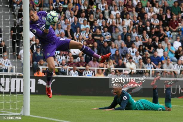 Tottenham Hotspur's English midfielder Dele Alli watches as Newcastle United's Slovakian goalkeeper Martin Dubravka saves his shot during the English...