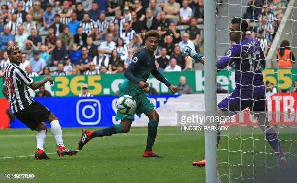Tottenham Hotspur's English midfielder Dele Alli watches the ball into the net after scoring his team's second goal during the English Premier League...