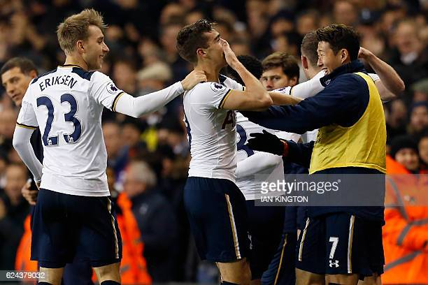 Tottenham Hotspur's English midfielder Harry Winks celebrates with teammates after scoring Tottenham's first goal during the English Premier League...