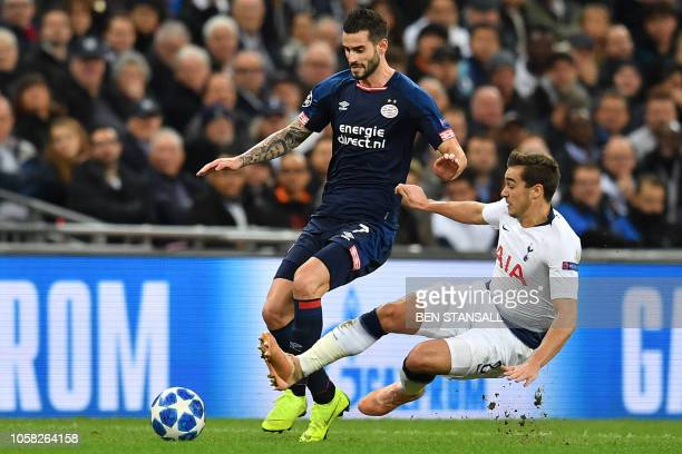 Tottenham Hotspur's English midfielder Harry Winks fouls PSV Eindhoven's Uruguayan midfielder Gaston Pereiro during the UEFA Champions League group B...
