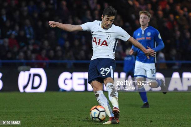Tottenham Hotspur's English midfielder Harry Winks has an unsuccessful shot during the English FA Cup fifth round football match between Rochdale and...