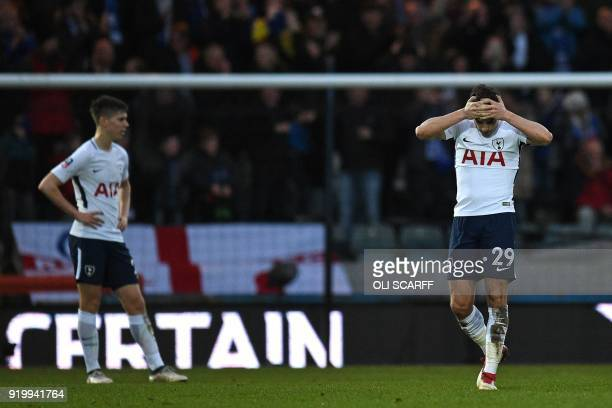 Tottenham Hotspur's English midfielder Harry Winks reacts after Rochdale take the lead during the English FA Cup fifth round football match between...